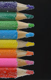 Colorful pencils close-up into water Royalty Free Stock Image