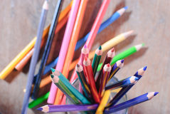 Colorful pencils on color wooden background Royalty Free Stock Image