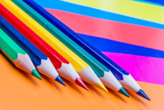 Colorful pencils on colored paper. Abstract background Royalty Free Stock Photo