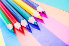 Colorful pencils on colored paper. Abstract background Royalty Free Stock Image