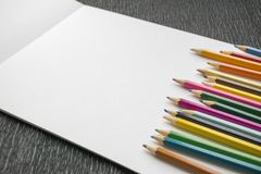 Colorful pencils copy space border over white template paper background. stock photography