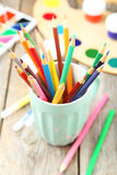 Colorful pencils in cup on the grey wooden background Stock Image