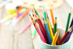 Colorful pencils in cup on the grey wooden background Stock Images