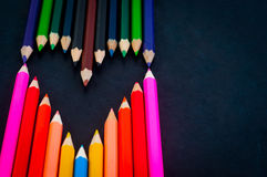 Colorful pencils on dark background Stock Photo