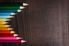 Colorful pencils on dark brown table Stock Photo
