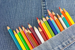 Colorful pencils in denim jeans pocket Stock Photo