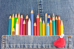 Colorful pencils in denim jeans pocket Stock Image