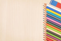 Colorful pencils and eraser Stock Photos