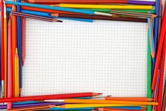 Colorful pencils frame. On blank paper sheet royalty free stock photo
