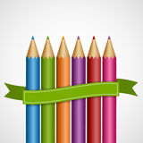Colorful pencils with green ribbon. Stock Photo