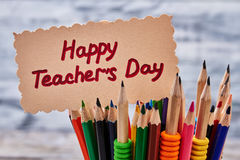 Colorful pencils and greeting card. Bright congratulation to Teacher`s Day Royalty Free Stock Photo