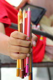 Colorful pencils in hand child Royalty Free Stock Photos