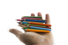 Colorful pencils in hand isolated on white background Stock Photography