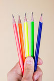 Colorful pencils in hand Stock Photos