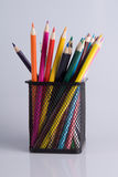 Colorful pencils in a holder on white Royalty Free Stock Images