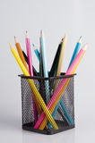 Colorful pencils in a holder on white Royalty Free Stock Photo