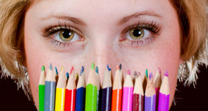 Colorful pencils & Lonely beautiful young woman Stock Image