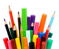 Colorful pencils and markers. An assortment of colorful markers and colored pencils royalty free stock photos