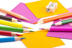 Colorful pencils and note papers Royalty Free Stock Photography