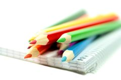 Colorful pencils on notebook Royalty Free Stock Photos