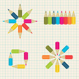 Colorful pencils on notebook background Royalty Free Stock Photo