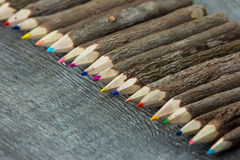 Colorful pencils on old wood background Stock Photos