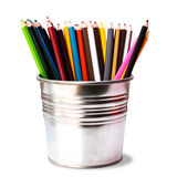 Colorful pencils in pail on white. Royalty Free Stock Photography