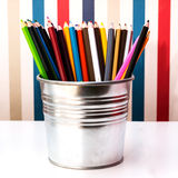 Colorful pencils in pail on white with clipping part. Royalty Free Stock Image