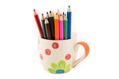 Colorful pencils in pail on white royalty free stock photos