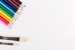 Colorful pencils and paintbrushes Royalty Free Stock Image