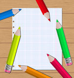 Colorful pencils on paper sheet background Royalty Free Stock Photos