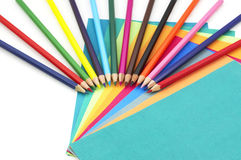Colorful pencils and papers. Are isolated Stock Image