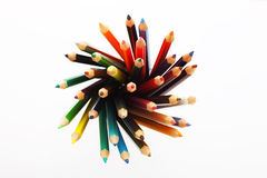 Colorful pencils in a pencil box on a white background Stock Photos