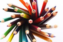 Colorful pencils in a pencil box on a white background Royalty Free Stock Image