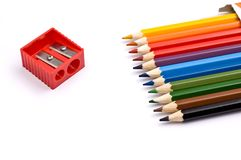 Colorful pencils with pencil sharpener Stock Photography