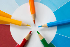 Colorful pencils with pie chart 4. Five colorful pencils with colored pie chart Stock Photography