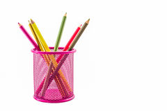 Colorful pencils in pink pail. Colorful pencils in pink pail on white background royalty free stock photo