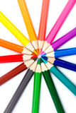 Colorful pencils in radial arrangement Royalty Free Stock Photos