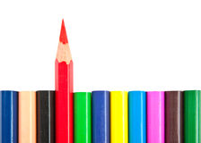 Colorful pencils with red one standing Royalty Free Stock Photos