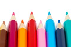 Colorful pencils in row on white background stock photo