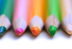 Colorful pencils in a row. Close-up stock images