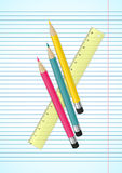 Colorful pencils and ruler on ruled paper Royalty Free Stock Photography