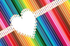 Colorful pencils set in middle of heart shape Royalty Free Stock Photo