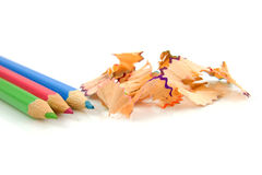 Colorful pencils with shavings Royalty Free Stock Photo