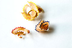 Colorful pencils shavings. Colorful pencil shavings in the white background Stock Photos
