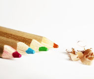 Colorful pencils and shavings Stock Images