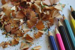 Colorful pencils and shavings from sharpening pencils. Colorful shavings background. Drawing and school table background. Creativity concept Royalty Free Stock Photography