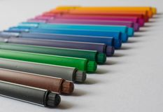 Colorful pencils sorted in line stock image