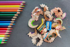 Colorful pencils and spiral rubbish Stock Images