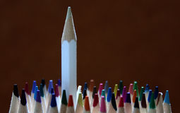 Colorful pencils. Standing out of the crowd Stock Photo